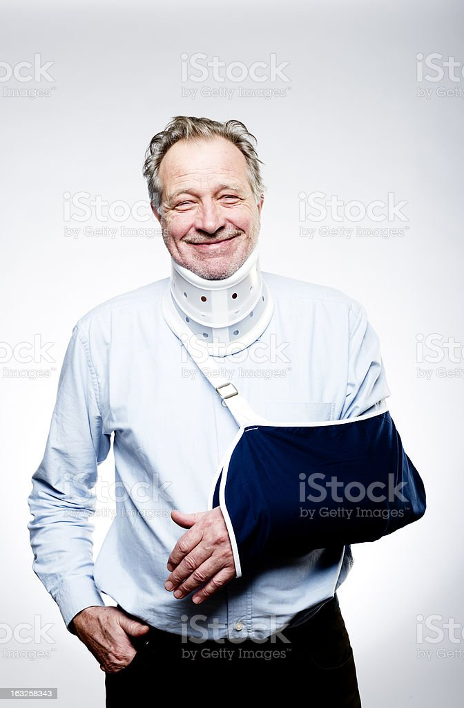 Senior Man Suffering From Whiplash With Neck Brace and Sling stock photo