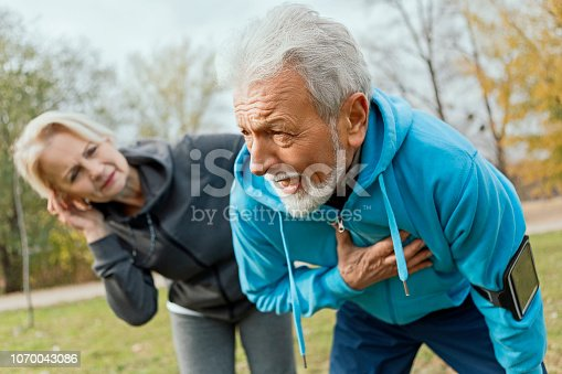 Senior Man Suffering Heart Attack Whilst Jogging with wife