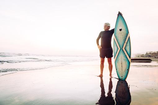 Senior man surfing