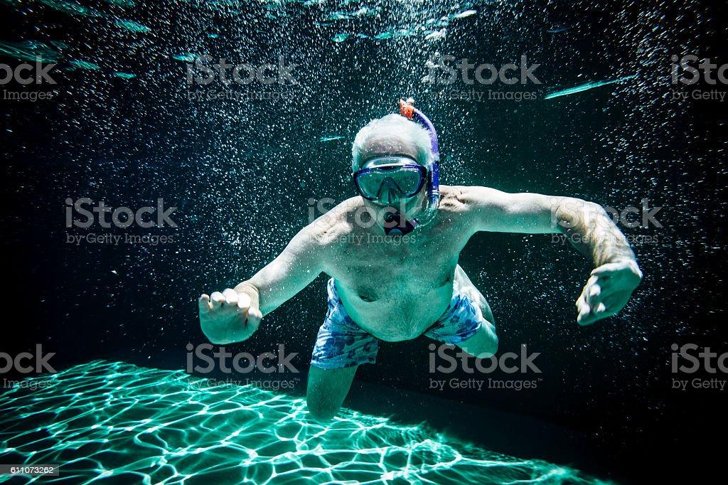 Senior Man Swimming Underwater Royalty Free Stock Photo