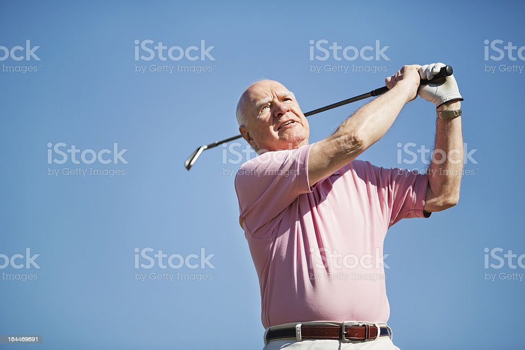 Senior Man Swinging Golf Club royalty-free stock photo