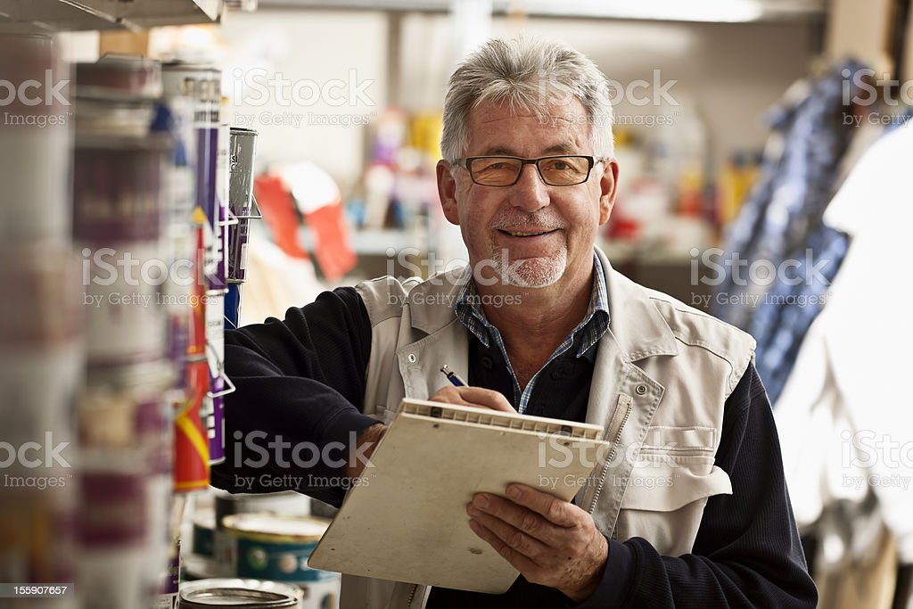 Senior Man Taking Inventory stock photo