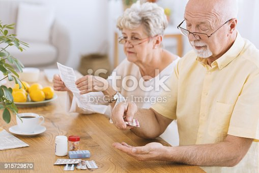 istock Senior man taking medicament 915729870