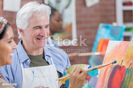 658645980 istock photo Senior man teaches art class 659542608