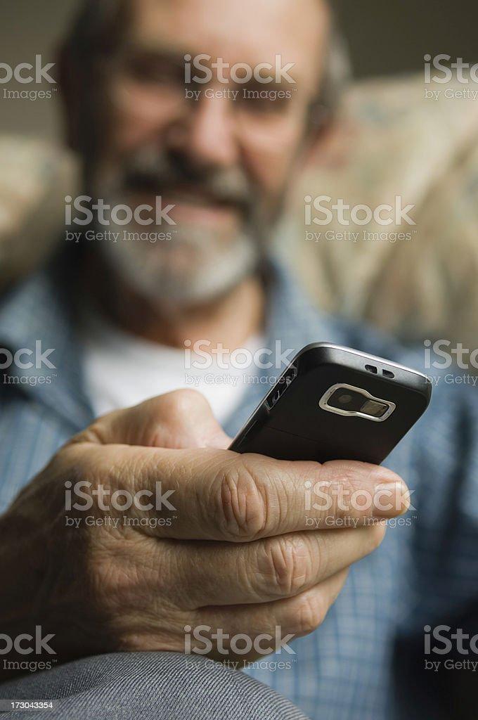 Senior man texting royalty-free stock photo