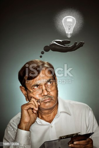 istock Senior man thinking idea by holding a pen and clipboard 168510004