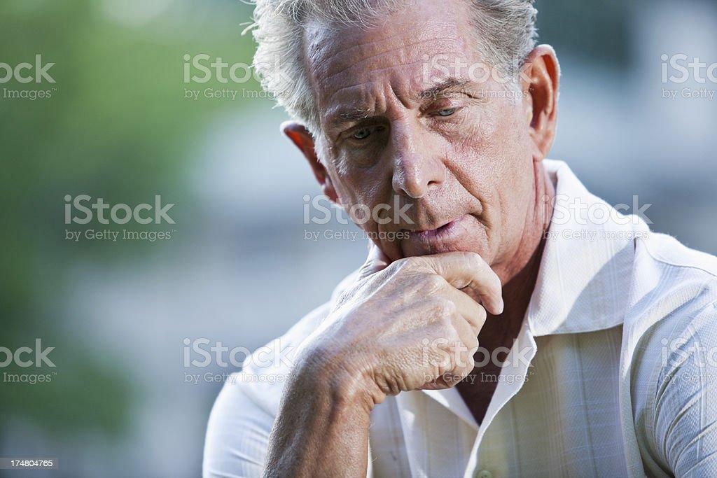 Senior man thinking stock photo