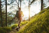 istock Senior man trail hiking in a mountain forest, in the Alps of Italy 1203027991