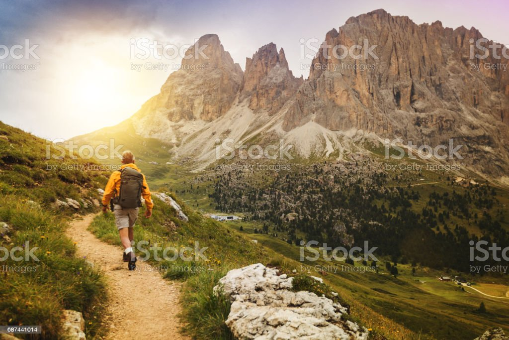 Senior man trail hiking on high mountain stock photo