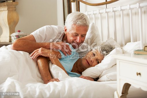 istock Senior Man Tries To Be Affectionate Towards Wife In Bed 171277148