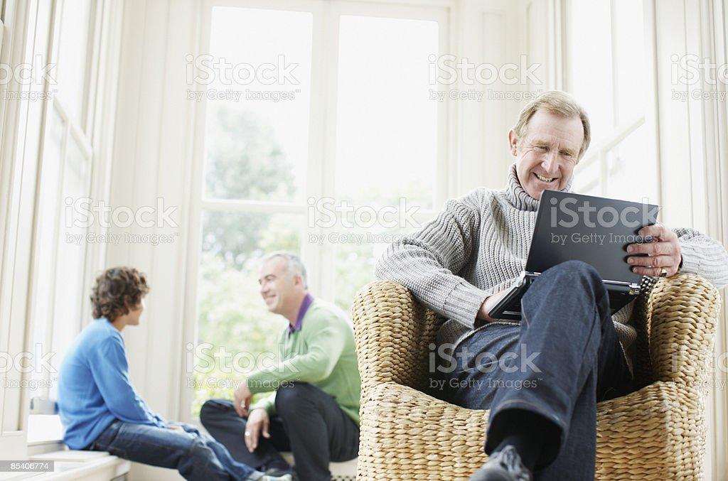 Senior man typing on laptop royalty-free stock photo
