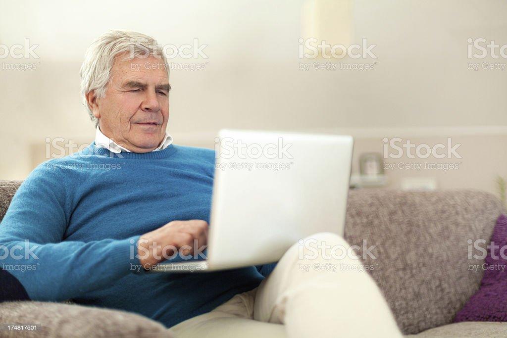 Senior man using a computer royalty-free stock photo