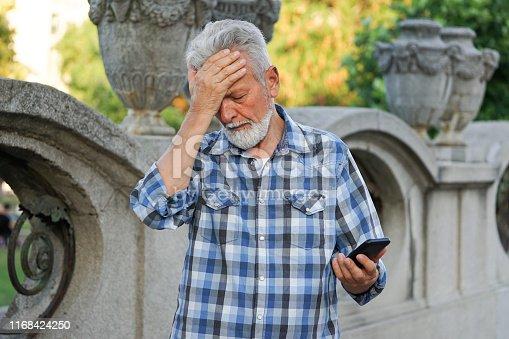 istock Senior man using a mobile phone 1168424250