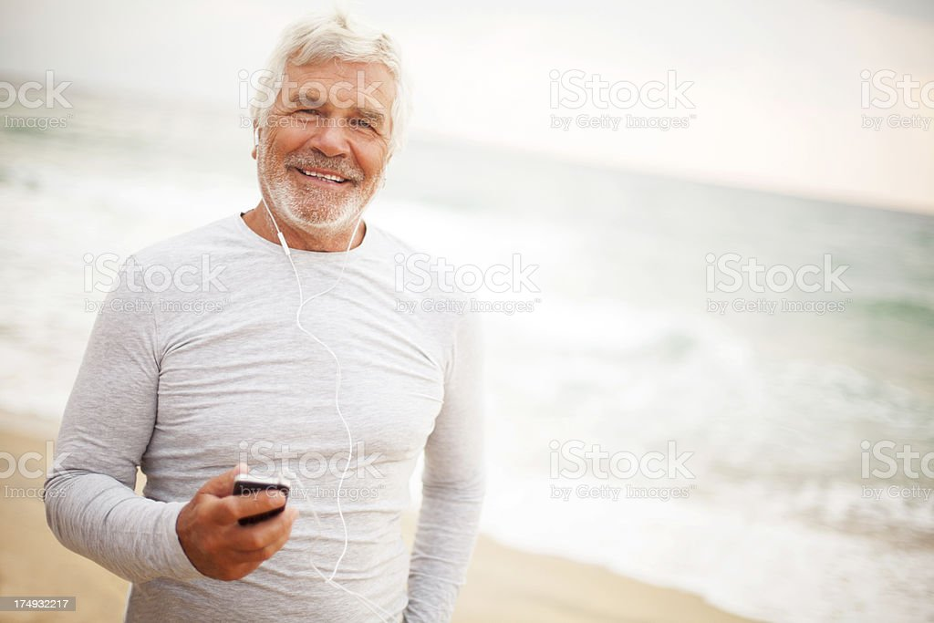 Senior man using a smartphone royalty-free stock photo