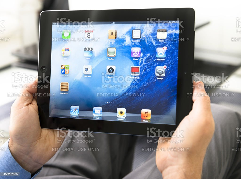 Senior man using an Ipad 3 on the living room royalty-free stock photo