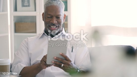 istock Senior man using digital tablet 1012627864
