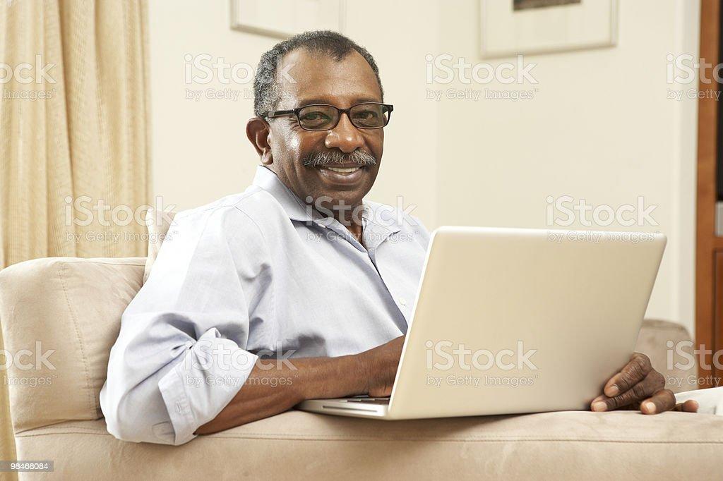 Senior Man Using Laptop At Home royalty-free stock photo