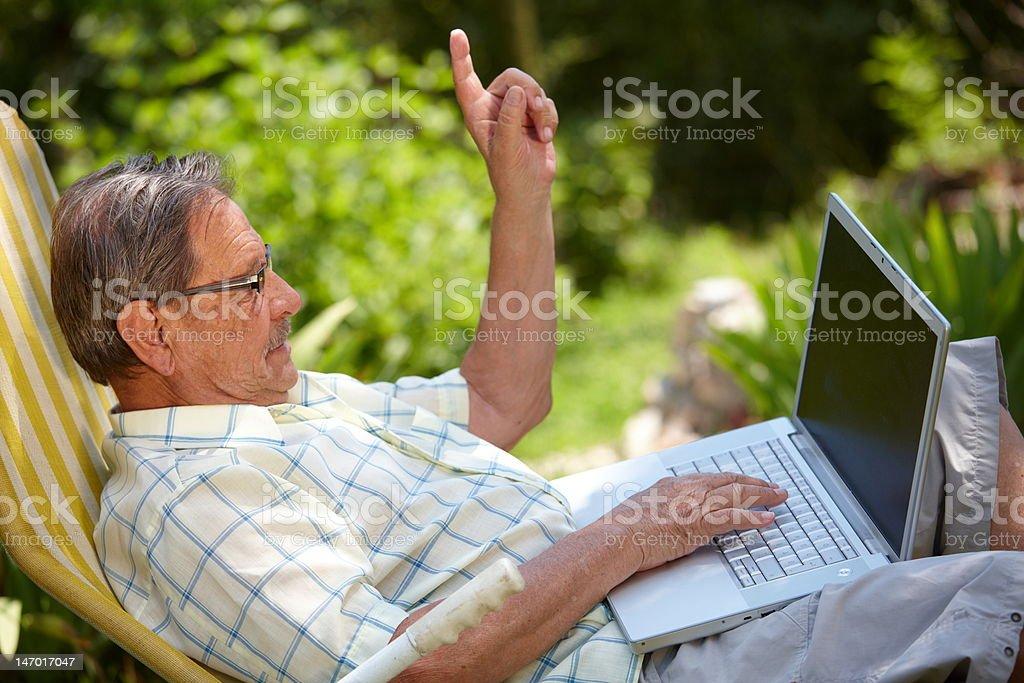Senior Man Using Laptop Outdoor royalty-free stock photo