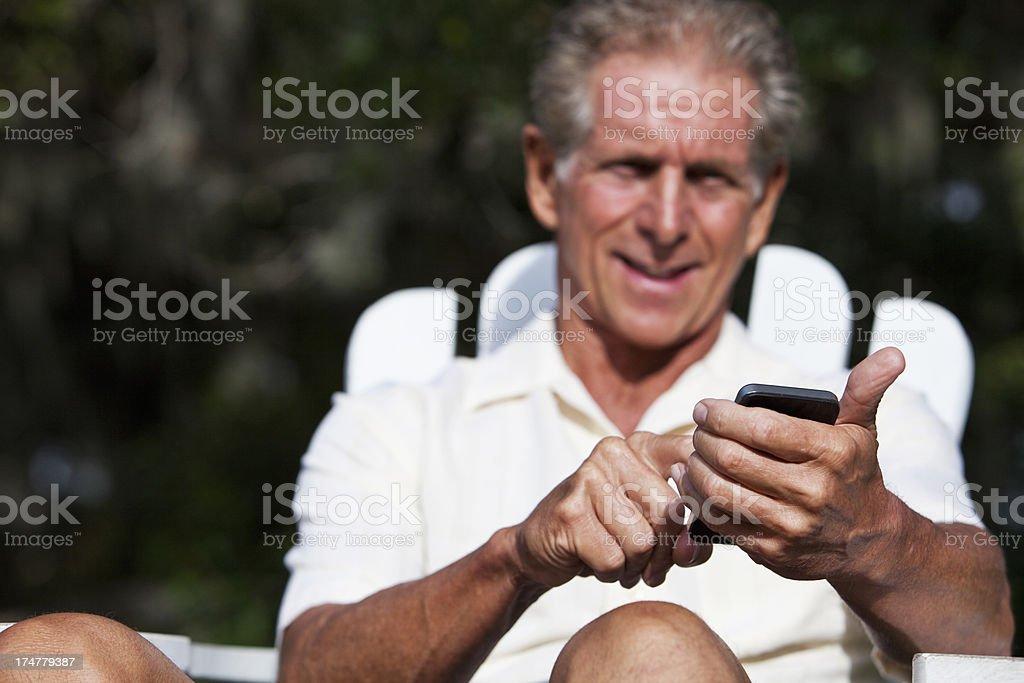 Senior man using mobile phone stock photo