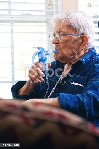 A 91 year old man using a nebulizer.
