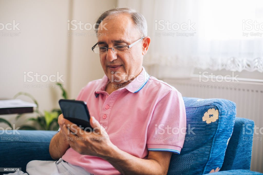 Senior Man Using Smartphone at Home - Royalty-free 60-69 Years Stock Photo