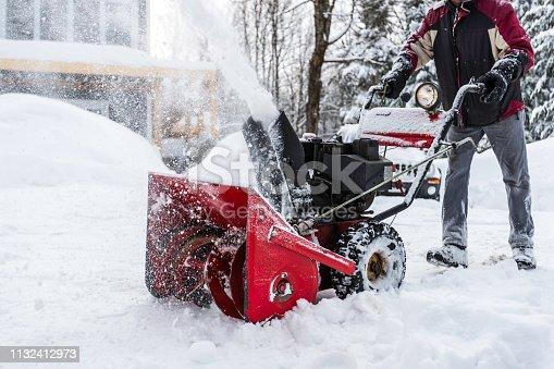 istock Senior Man Using SnowBlower After a Snowstorm 1132412973