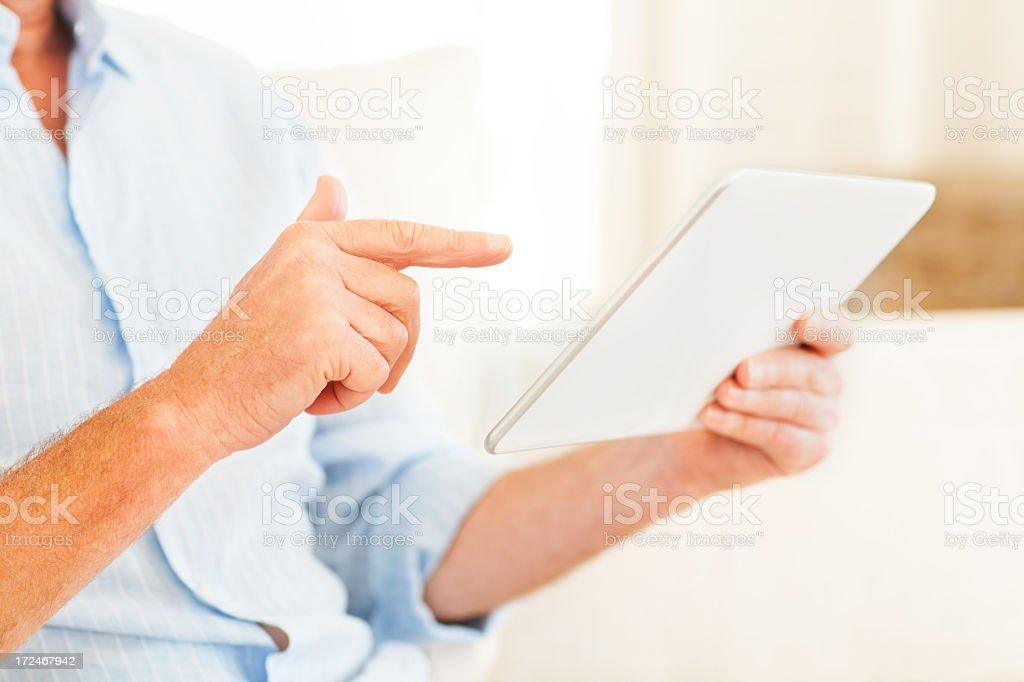 Senior Man Using Tablet Computer royalty-free stock photo