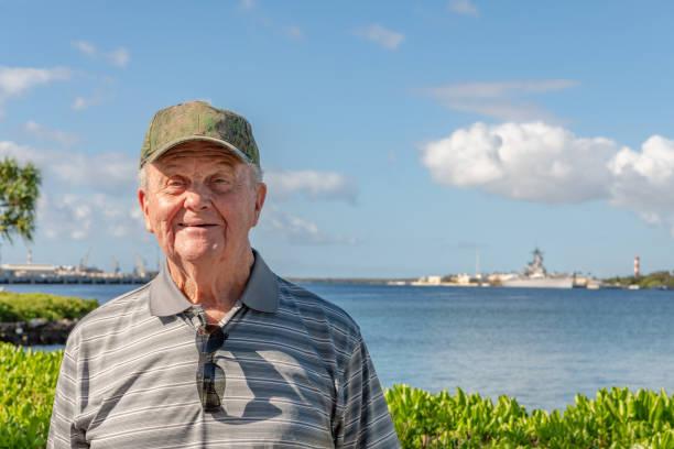 Senior man visiting Hawaii. Wearing hat stock photo