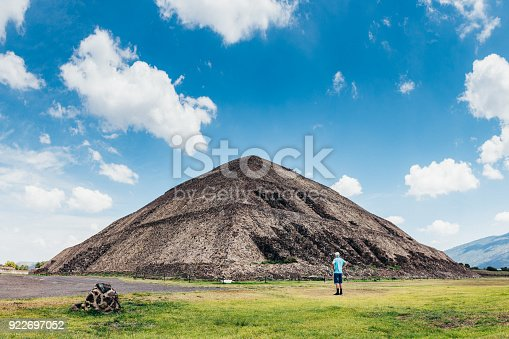 Senior man visiting the sun Pyramid in Teotihuacan Mexico.