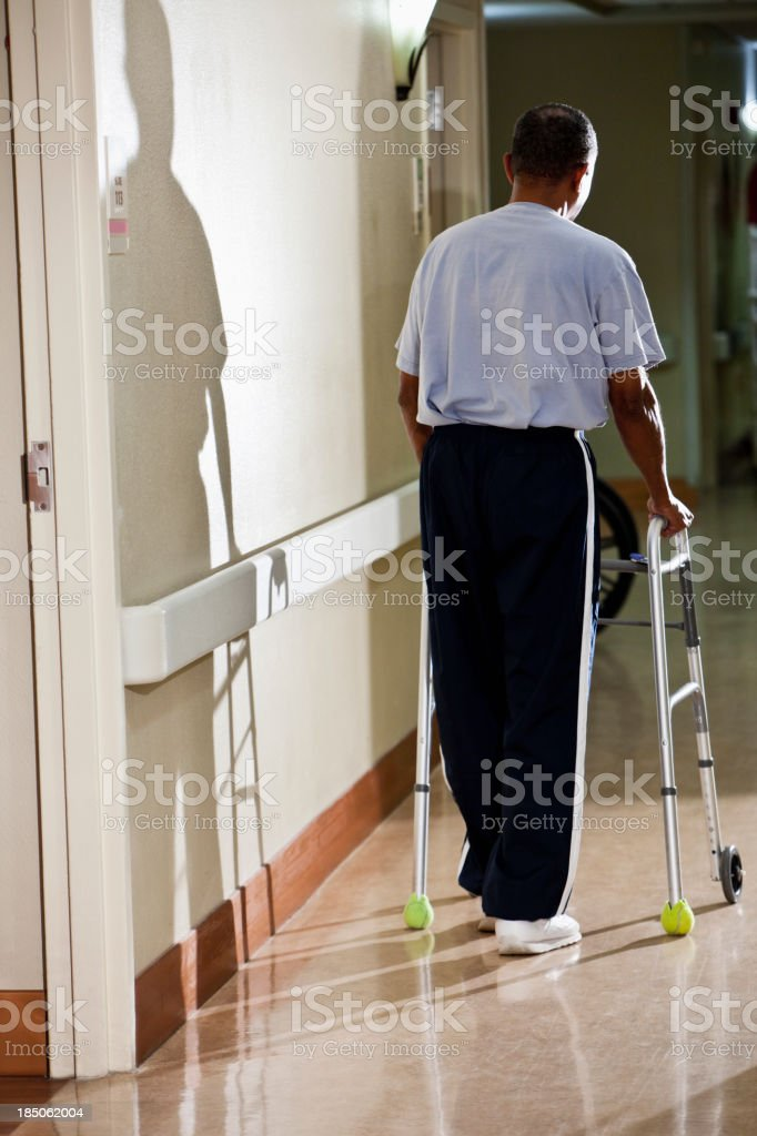 Senior man walking down hospital corridor royalty-free stock photo