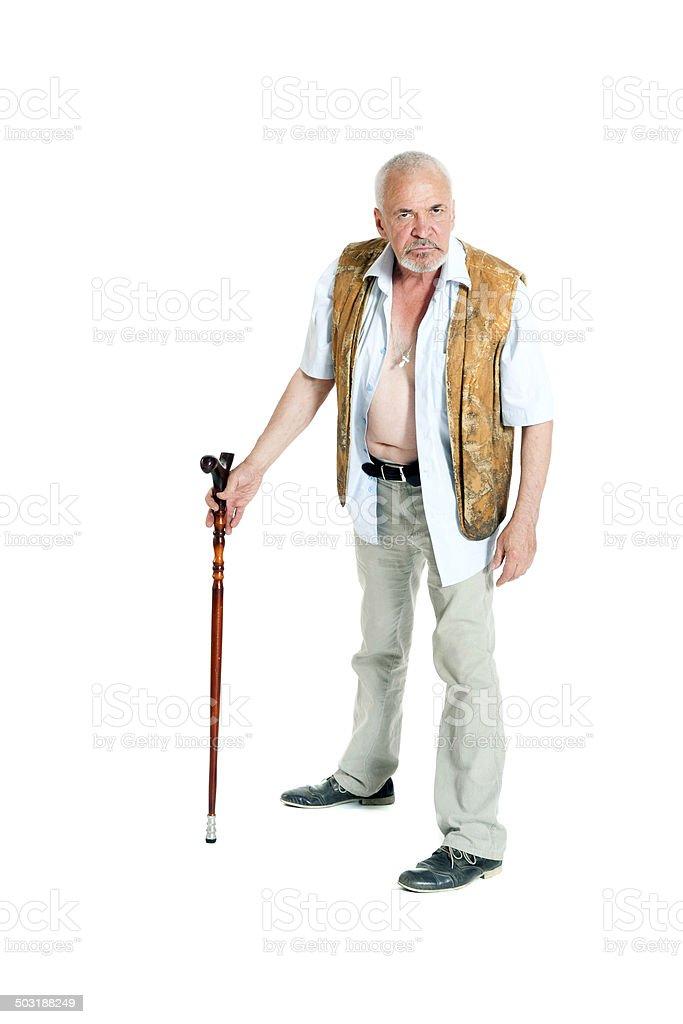 Senior man walking with a cane stock photo