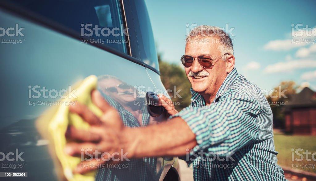 Senior man washing car stock photo