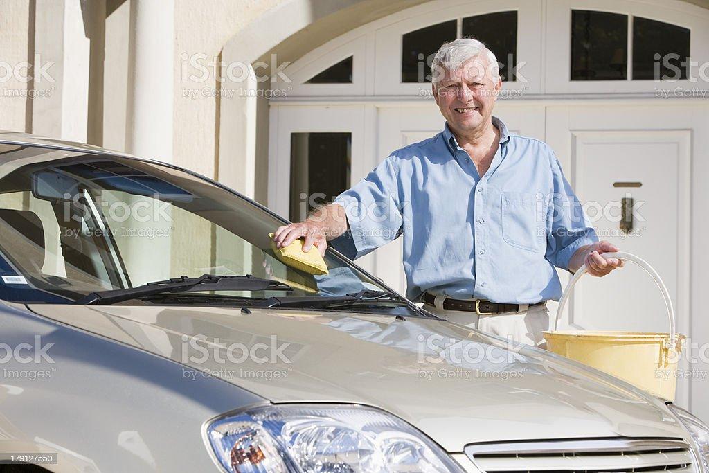Senior man washing car royalty-free stock photo