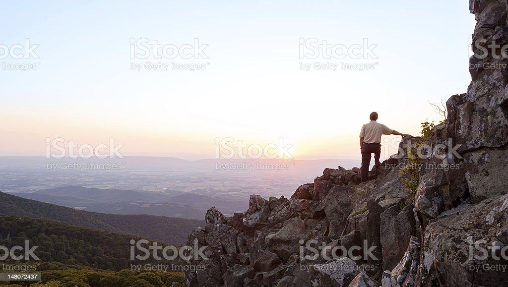 Senior man watches sunrise over blue ridge stock photo