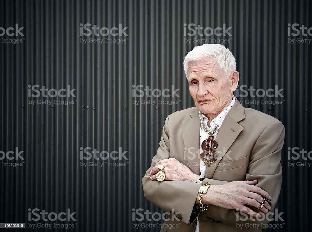 Senior Man Wearing Gold Jewelry stock photo