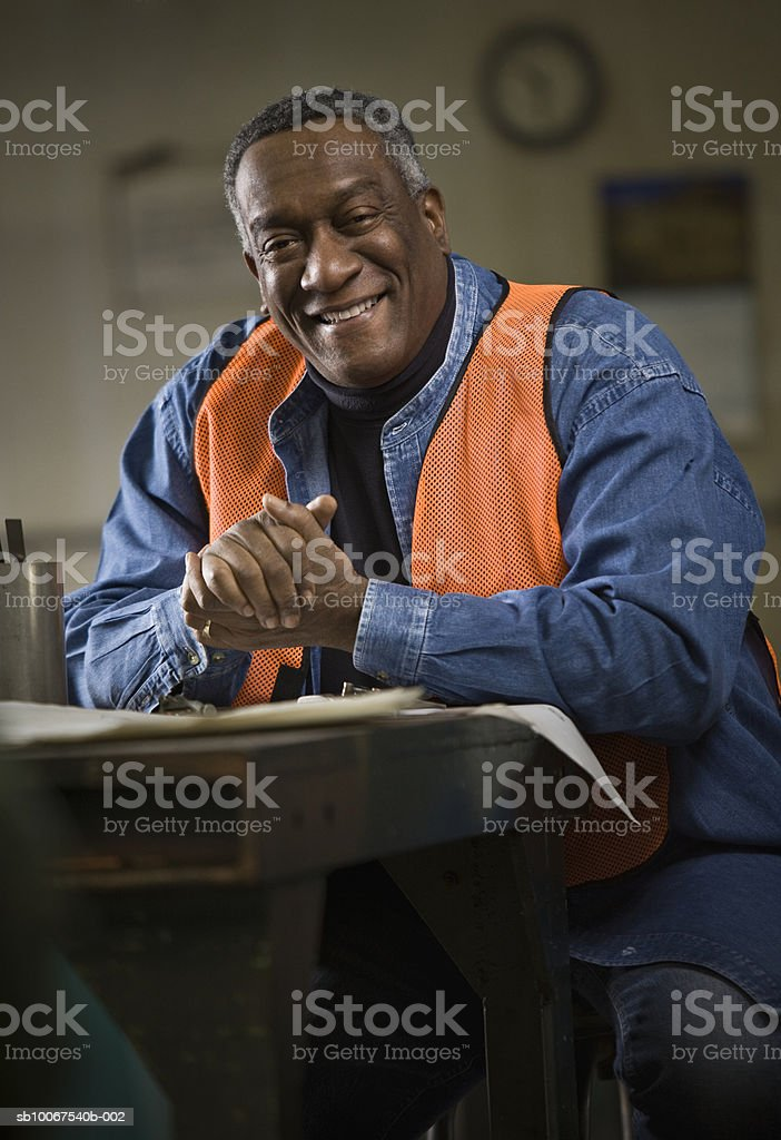 Senior man wearing safety vest, smiling, portrait 免版稅 stock photo