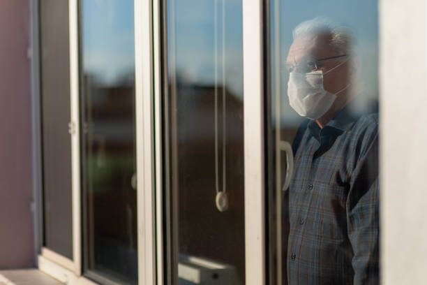 senior man who cannot leave the house due to an epidemic people who cannot leave the house due to an epidemic pandemic illness stock pictures, royalty-free photos & images