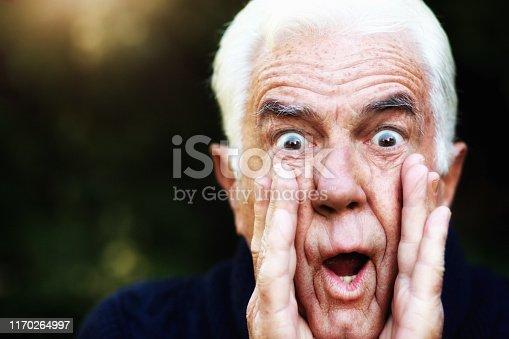 661896674istockphoto Senior man, wide-eyed and alarmed, shouts warning 1170264997