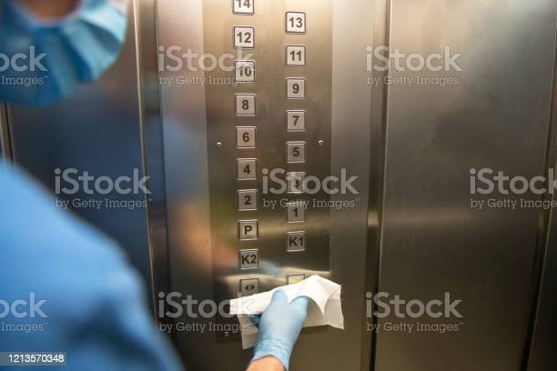 Senior man wiping down the inside of the elevator for covid19 europe picture id1213570348?b=1&k=6&m=1213570348&s=612x612&h=ni0xkzmfifcjcgkhlrgy793ug0cntqvs9tt10x70hny=