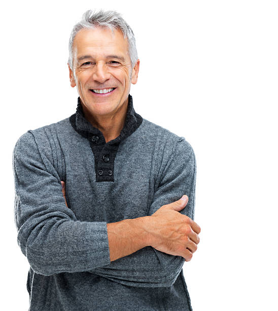 Senior man with a content smile Portrait of a smiling senior man with arms crossed while isolated on a white background 60 64 years stock pictures, royalty-free photos & images
