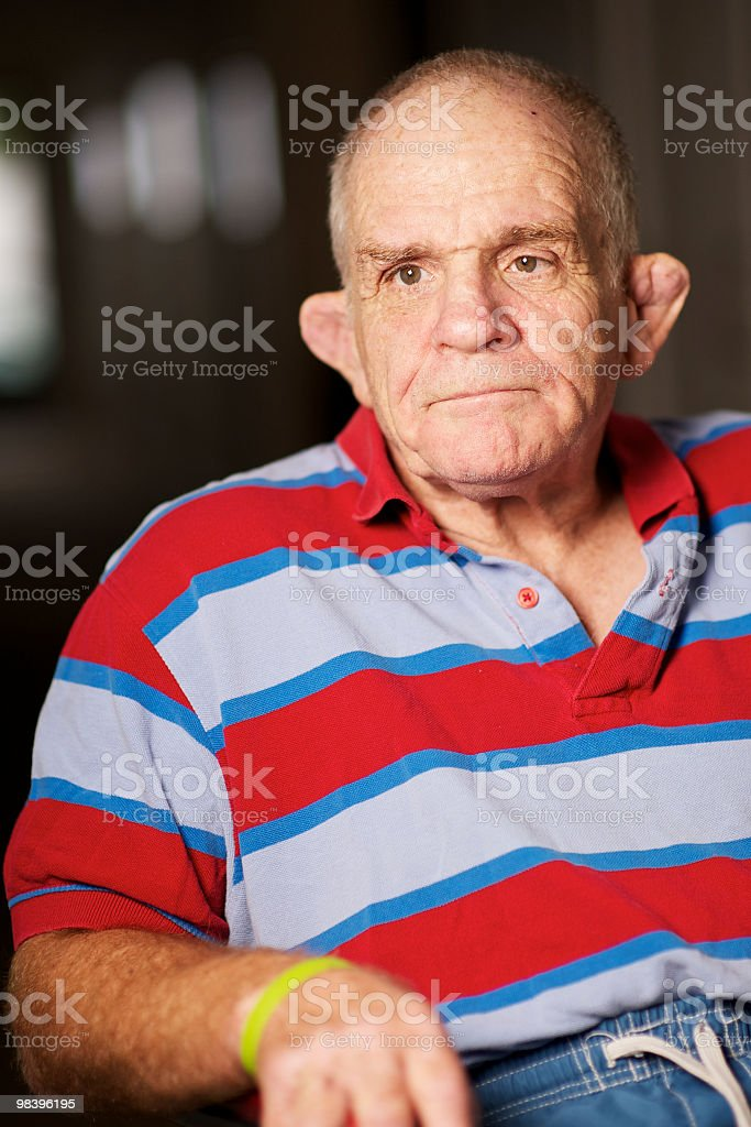 Senior man with a disability and pensive expression. royalty-free stock photo