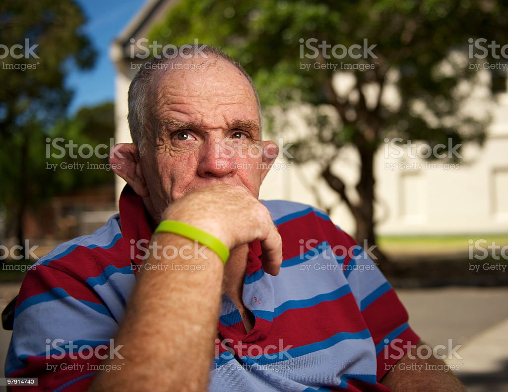 Senior man with a disability thinking deeply royalty-free stock photo