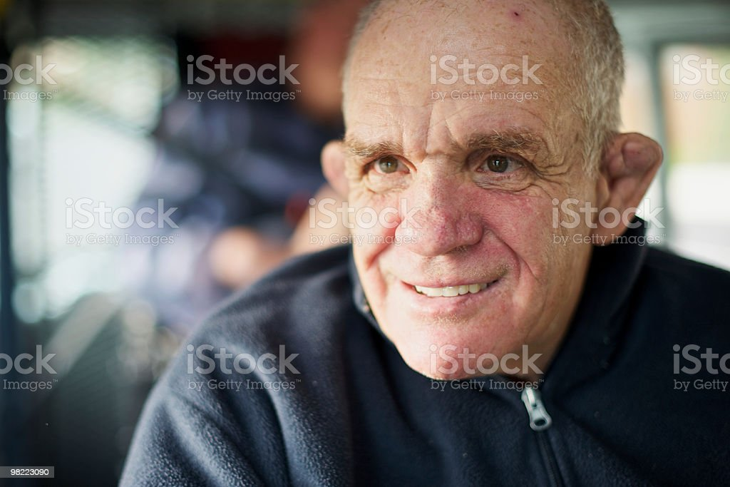 Senior man with an intellectual disability caught in window light royalty-free stock photo