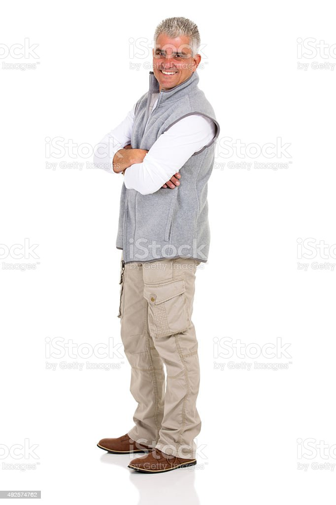 senior man with arms crossed stock photo