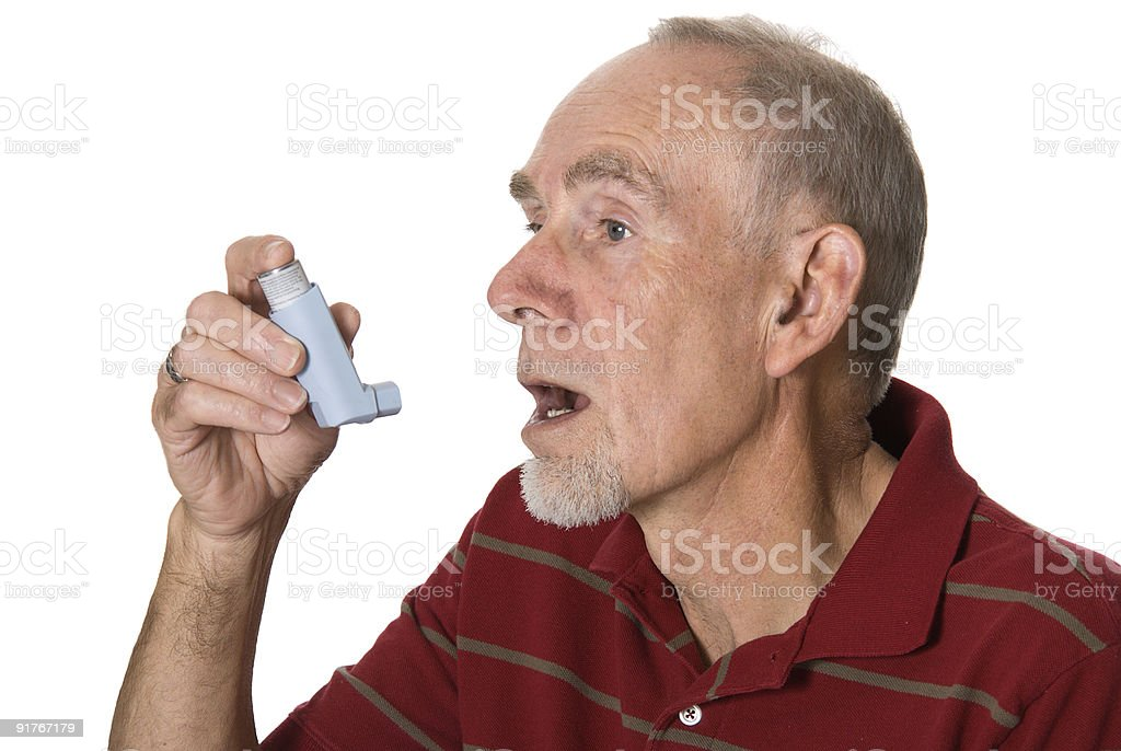 Senior man with asthma inhaler royalty-free stock photo