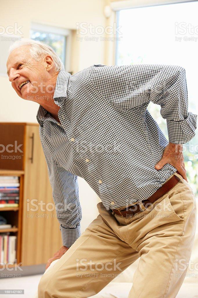 Senior man with backache stock photo
