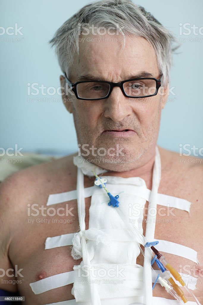 Senior man with bandage on chest stock photo