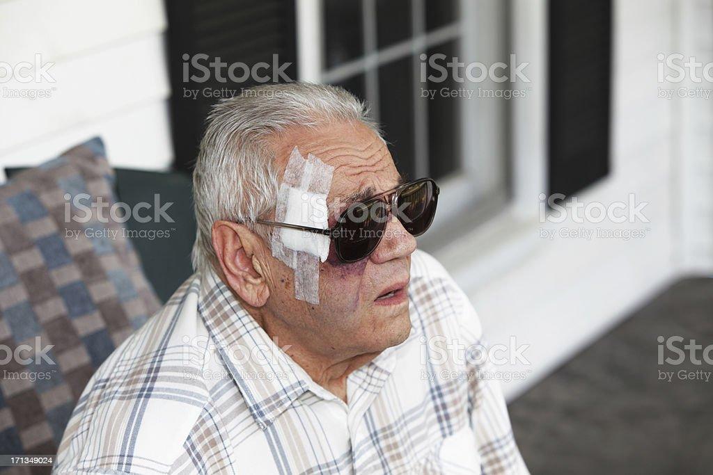 Senior Man With Bandaged Head stock photo