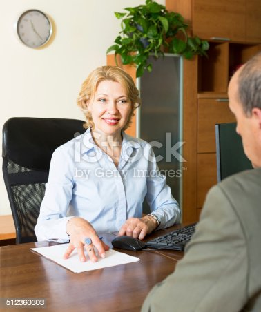 584597964 istock photo Senior man with bank manager 512360303