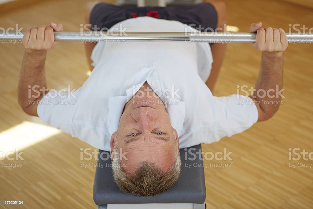 Senior man with barbell royalty-free stock photo